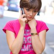 Sad girl with mobile phone — Stock Photo