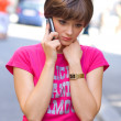 Stock Photo: Sad girl with mobile phone