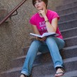 Teen girl with book on the stairs — Stock Photo #22202101