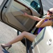 Woman with great legs exit the car — Stock fotografie