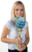 Young woman with sport trophy — Stock Photo