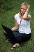 Woman with laptop outside — Foto de Stock