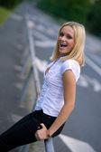 Teen girl smiling on the street — Stock Photo