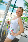 Smiling girl in white summer clothes — Stock Photo