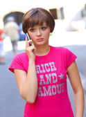 Sad girl with mobile phone — Stock Photo