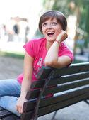 Teen girl on the bench — Stock Photo
