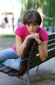 Teen girl on the bench — Stock Photo