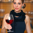 Attractive woman with wine — Stock Photo #22304761