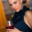 Attractive woman with wine — Stock Photo #22304851