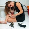 Drunk woman in her bathroom — Stock Photo #22306273