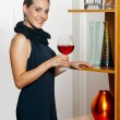 Attractive woman with wine — Stock Photo #22306459