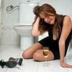 Drunk woman in her bathroom — Stock Photo #22306475