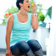 Middle age womeating apple — Stock Photo #22308301