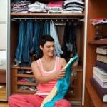 Woman choosing clothes — Stock Photo #22308355