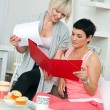 Stock Photo: Two mature woman friends working at home