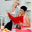 Two mature woman friends working at home — Stock Photo