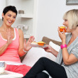 Two mature woman friends chating over coffee — Stock Photo #22308555