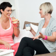 Stock Photo: Two mature womfriends chating over coffee