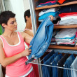 Woman choosing clothes — Stock Photo #22308653