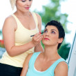 Putting make up — Stock Photo