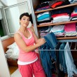 Woman choosing clothes — Stock Photo #22308851