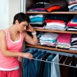 Stock Photo: Woman choosing clothes