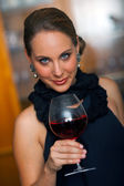 Attractive woman with wine — Stock Photo