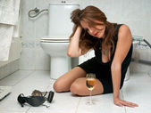 Drunk woman in her bathroom — Stock Photo