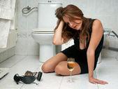 Drunk woman in her bathroom — Stock Photo