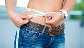 Woman measure her waist — Stock Photo