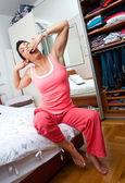 Sleepy woman on her bed — Stock Photo