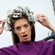 Unhappy woman in hair salon — Stock Photo