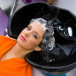 Woman with shampoo on her head — Stock Photo