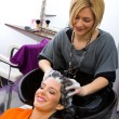 Stock Photo: Hair stylist washing womhair