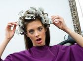 Unhappy woman in hair salon — Stock Photo