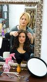 Hair stylist at work — Stock Photo