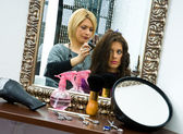 Hair stylist at work — Stock Photo