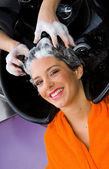 Woman with shampoo on her hair — Stock Photo