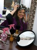 Happy woman in hair salon — Stock Photo