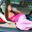 Woman in sleeping bag with water bottle — Stock Photo #22732625