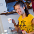 Stock Photo: Teen girl at breakfast