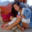 Teen girl polish her toenails — Stockfoto
