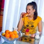Teen girl at breakfast — Stock Photo #22733781