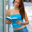 Teen girl with book outside — 图库照片