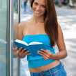 Foto Stock: Teen girl with book outside