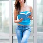 Teen girl reading book — Stock Photo #22737847
