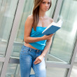 Teen girl with book outside — Stock Photo