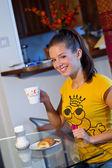Teen girl at breakfast — Stock Photo