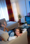 Teen girl on the sofa — Stock Photo