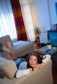 Teen girl on the sofa — Stock Photo